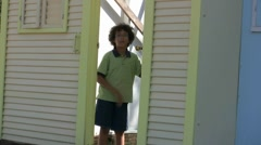 American Kid Playing In Door On Farm In Texas Stock Footage
