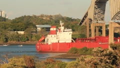 Cargo Freighter Passes Under a Bridge in Panama - stock footage