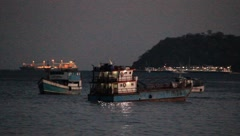 Early morning fishing boats out for the big catch Stock Footage
