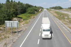 Rural highway with trucks. SD. Stock Footage