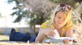 Beautiful Girl Reading in Park 4955 HD Footage