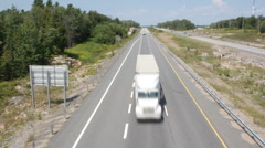 Rural highway with trucks. Stock Footage
