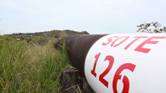Oil pipeline running along an Andean ridgetop - stock footage