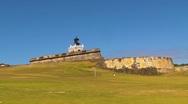 Puerto Rico - El Morro Fortress and girl meditating Stock Footage