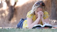 Stock Video Footage of Woman Praying in Park
