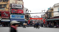Stock Video Footage of The Bustling Street Scene Of Hanoi, Vietnam, Old Town, Motorcycles, Cars Traffic