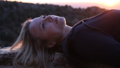 Attractive young woman relaxing Stock Footage