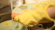 Woman washing dishes Stock Footage