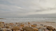 Wild ocean and cobble stones Stock Footage