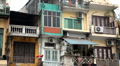 The Bustling Street Scene Of Hanoi, Vietnam, Old Town, Colorful Old Poor Houses Footage