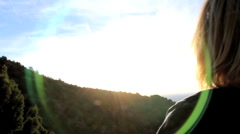Watching Mountainside sunset Stock Footage