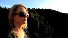 Beautiful woman savors sunset - stock footage