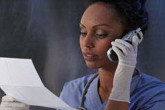 Nurse with test results. SD. Stock Footage