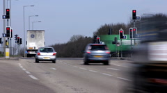 Time lapse of traffic at light controlled junction Northamptonshire England - stock footage