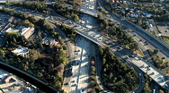 Speed Up Aerial View of Los Angeles Freeway / Highway / Suburbs - Clip 7 Stock Footage