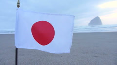 Zoom Out Japan Flag Waving at Ocean Stock Footage