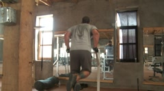 Man Work Out in Primitive Gym (HD) co Stock Footage