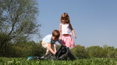 Boy and little girl begins to unfold tent - stock footage