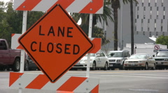 Lane closed sign - Medium close up shot Stock Footage