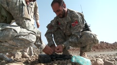 Afghan Soldier making bomb (HD) k - stock footage