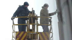 Men removing ice from the roof Stock Footage