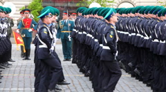 Frontier guards march front military brass band on rehearsal of parade Stock Footage