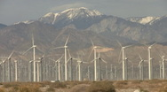Stock Video Footage of Palm Springs Wind Farm with Snow Capped Mountains