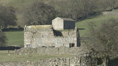 Stone built field barns near Reeth, Swaledale. Stock Footage