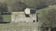 Stock Video Footage of Stone built field barns near Reeth, Swaledale.