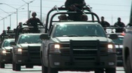 Stock Video Footage of Mexican Police Convoy (HD) co