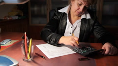Business woman fills out a 1040 tax form. slider shot. 3. Stock Footage