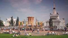 People near fountain of nations friendship and exhibition halls Stock Footage