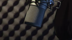 Microphone in a sound booth - stock footage