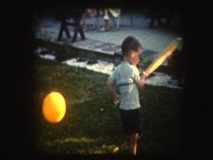Cute Little boy swings baseball bat  Stock Footage