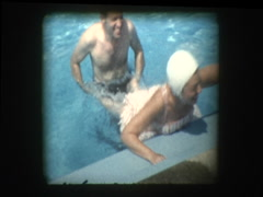 Young newlywed couple plays in pool Stock Footage