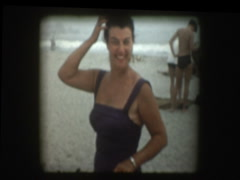 glam woman on beach 1958 - stock footage