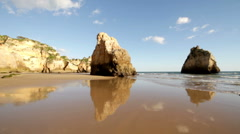 Rocks and ocean at Praia Tres Irmaos in Alvor Portugal - stock footage