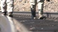 TRN-0001 Feet Walking on Railroad Tracks Stock Footage
