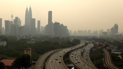 Kuala Lumpur Skyline Aerial View Commuters Commuting Highway Cars Traffic Day - stock footage