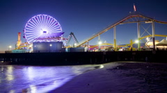 Carnival Rides on Santa Monica Pier Night in Los Angeles, California, Time Lapse Stock Footage
