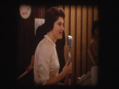 50's woman speaks on old microphone - stock footage