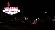 Vegas sign with strip V1 - HD Stock Footage