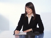 Female executive at desk. SD. Stock Footage