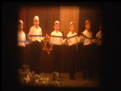 Jewish boys in play at synagogue hold Star of David Stock Footage