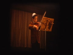 Jewish boy plays Violin at recital - stock footage