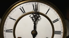 Old antique clock chiming 12 o'clock Stock Footage