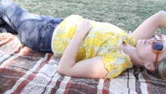 Woman relaxing outdoors Stock Footage