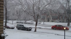 Snow falling residential suburbs Stock Footage