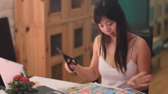 Young Chinese woman clips coupons - series 2 cutting coupon perfectly Stock Footage