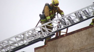 Firefighters climb down ladder Stock Footage